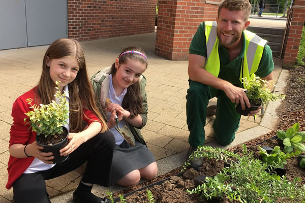 Green-fingered pupils bring Flemingate into bloom